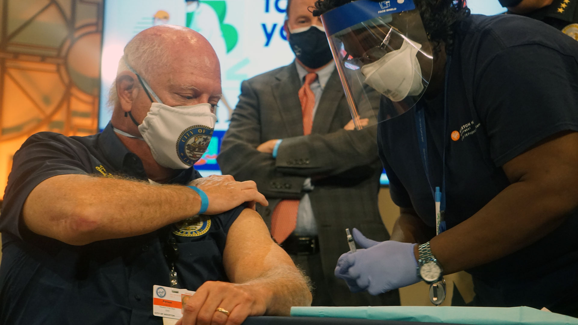 Image of person getting COVID-19 vaccination.